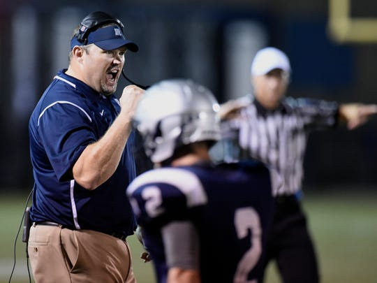 Reitz High football head coach Andy Hape reacts after his teams defense makes a stop on a Central fourth down during a game last season against Central at the Reitz Bowl.