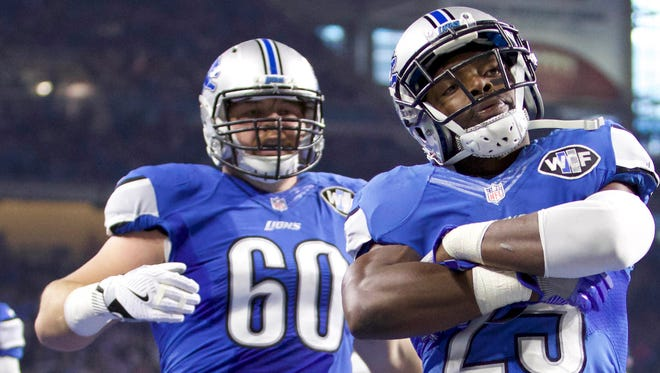 Oct 9, 2016; Detroit, MI, USA; Lions running back Theo Riddick (25) celebrates with center Graham Glasgow and receiver Marvin Jones, left, after a touchdown run against the Eagles at Ford Field.