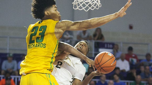 The Patrick School's Nick Richards defends Hudson Catholic's Louis King during play Sunday at the Culligan City of Palms Calssic at the Suncoast Credit Union Arena in Fort Myers.