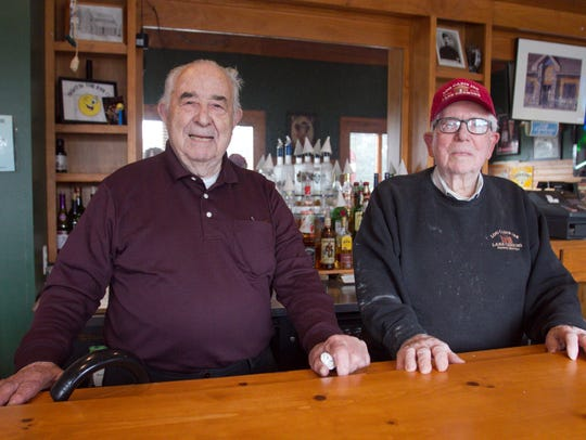Nick Kovanis, left, owner of the Log Cabin Inn in Genoa