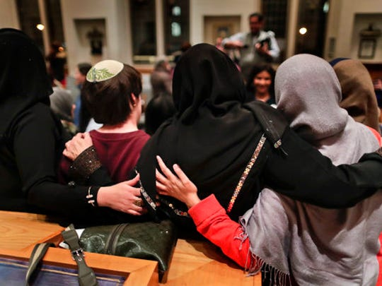 In this Thursday, Feb. 16, 2017 photo, members of the Sisterhood Salaam Shalom, gather for a group photo after a unity vigil held at the Jewish Theological Seminary in New York. The Sisterhood of Salaam Shalom, a national organization that brings together Muslim and Jewish women, organized the gathering as part of the organization's response to President Donald Trump's travel ban.