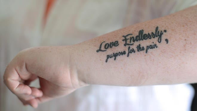 One of Amy Bleuel's semicolon tattoos is this one on her forearm. Bleuel lost her father to suicide in 2003 and started Project Semicolon in 2013.