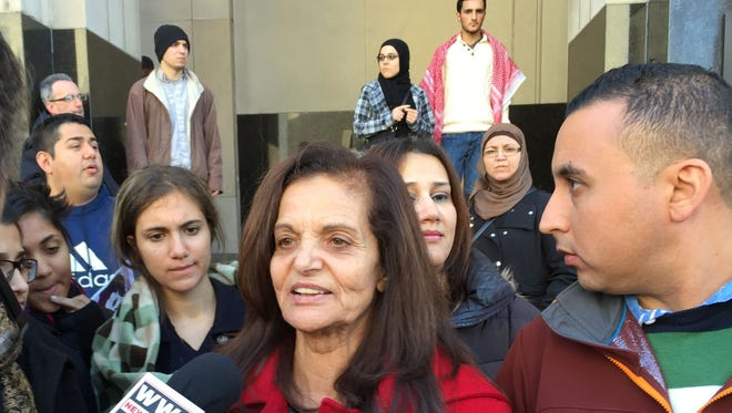 Rasmieh Odeh, 67, talks to reporters outside of Federal Court in Detroit on Monday after she was found guilty of not disclosing that she had been convicted in a 1969 Israel bombing when she was applying for U.S. citizenship.