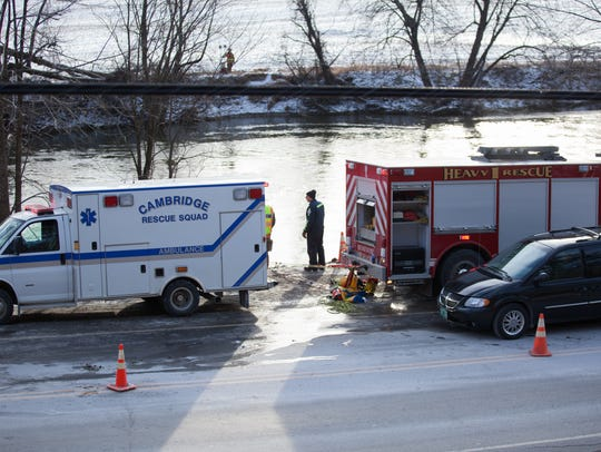 Recovery crew attempt to recover submerged car and