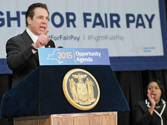 Gov. Andrew Cuomo delivers a speech during the Fight for Fair Pay Campaign Rally Wednesday in Rochester.