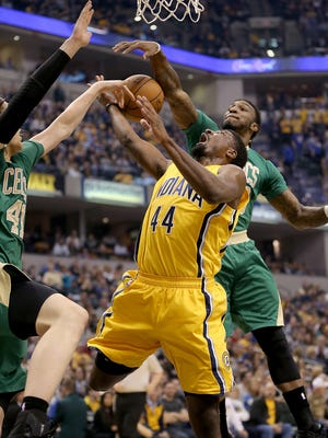 /p44/ has his shot blocked by Boston Celtics forward Jae Crowder (99),right, in the first half of their game Saturday, March 14, 2015, evening at Bankers Life Fieldhouse.