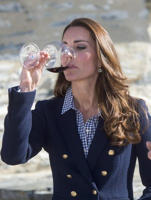 Duchess Kate sips some pinot noir at a wine-tasting visit to Amisfield Winery in Queenstown, N.Z., on April 13, damping down pregnancy rumors.