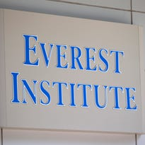 This file photo shows an Everest Institute sign on an office building in Silver Spring, Md. Everest is one of the 28 remaining ground college campuses Corinthian Colleges will shut down, displacing about 16,000 students.