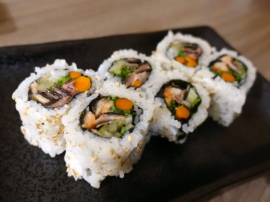 Salmon skin maki with cucumber, kaiware, burdock and