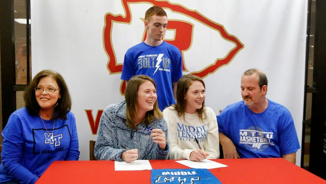 Alexis Whittington, center left,  and Amanda Whittington center right, signs to play college basketball for MTSU on signing day, Wednesday, Nov. 8 ,2017, with their parents Rob and Sandra Whittington and thier brother Preston Whittington, 15.
