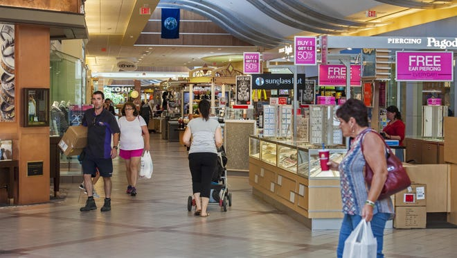 Shoppers walk the halls of the University Mall in South Burlington on Thursday.