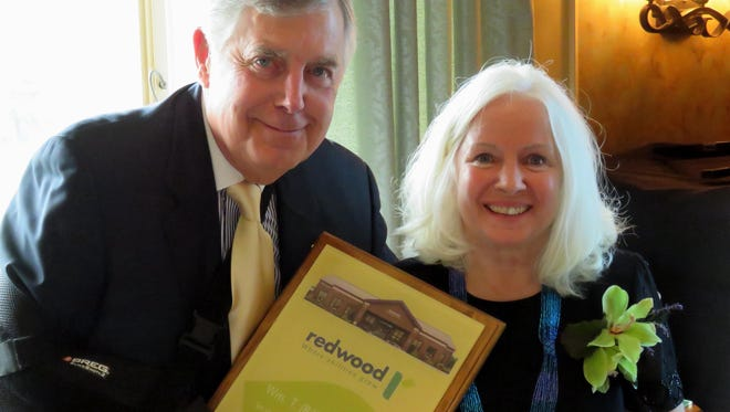 Barbara Howard, retiring Redwood executive director and CEO Emeritus, receives accolades from William Robinson III for her 36 years of dedicated service to Redwood.