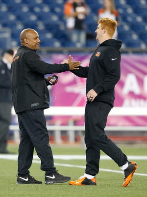 Bengals offensive coordinator Hue Jackson greets quarterback Andy Dalton before Cincinnati's game at New England.