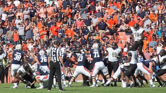 Vanderbilt linebacker Zach Cunningham (41) blocks a kick attempt by Auburn place kicker Daniel Carlson (38) during the NCAA football game between Auburn and Vanderbilt Saturday, Nov. 5, 2016, at Jordan-Hare Stadium in Auburn, Ala.Albert Cesare / Advertiser