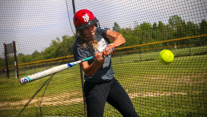 New Palestine junior Ashley Prange, 17, hits in the batting cage after the team's softball practice at the high school, New Palestine, Ind., Wednesday, May 17, 2017. Prange leads the state in home runs this season and will compete with the Dragons against Herron High School in sectionals on May 22, 2017.