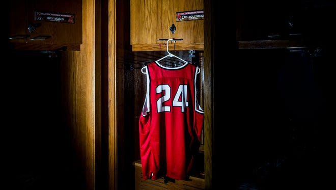 The jersey and locker of Zach Hollywood at Worthen Arena.