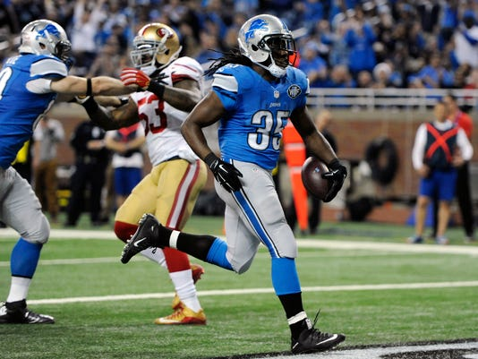 Detroit Lions running back Joique Bell crosses into the end zone for a touchdown during the first half of an NFL football game against the San Francisco 49ers, Sunday, Dec. 27, 2015, in Detroit. (AP Photo/Jose Juarez)