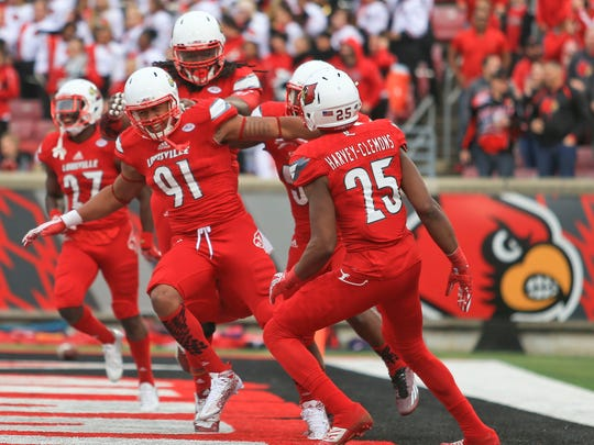 Louisville's Trevon Young celebrates with his defensive teammates as the Cards routed Syracuse 41-17 Saturday. Young had three tackles.