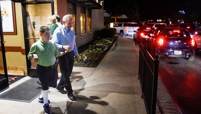 HK Derryberry gets help from his longtime friend and mentor Jim Bradford as they leave the Chick-fil-A in Brentwood after their weekly visit. The two met when Derryberry, who is blind and has cerebral palsy, was 9 at a Mrs. Winner's Chicken & Biscuits.