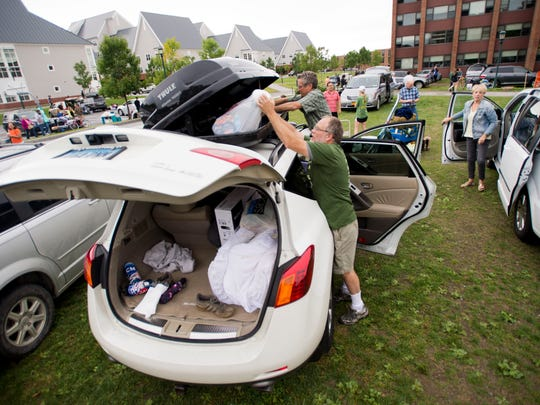 Parents flood into University Heights at the University of Vermont, unloading everything from skis to mini fridges during Move In Day Friday, August 22, 2014.