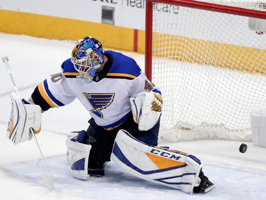St. Louis Blues goalie Carter Hutton (40) is unable to stop a shot by Dallas Stars left wing Jamie Benn in overtime of an NHL hockey game Saturday, March 3, 2018, in Dallas. The Stars won 3-2. (AP Photo/Tony Gutierrez)
