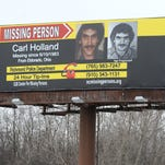 A billboard seen by travelers headed west on Interstate 70 near U.S. 40 Wednesday, Feb. 10, 2016,  in Richmond brings attention to the disappearance of  Carl Holland.