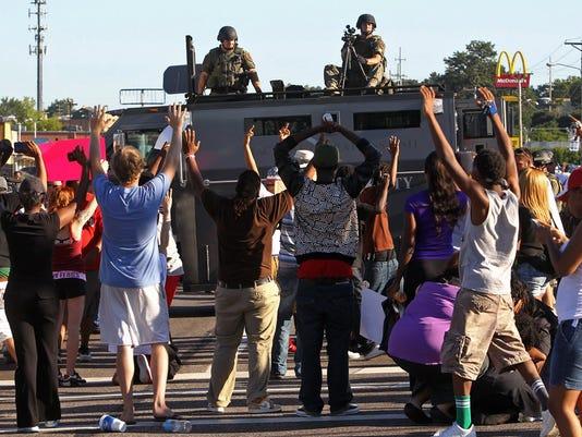 Ferguson protesters police