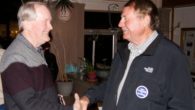 Dr. Mark Donnell, left, congratulates retired WNMU professor Ken Ladner on winning the mayor's race Tuesday at the Silver City city hall.