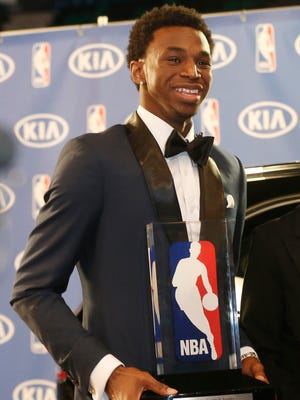 Minnesota Timberwolves' Andrew Wiggins holds his Rookie of the Year trophy.