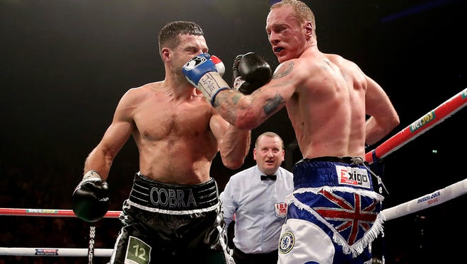 Carl Froch, left, and George Groves trade punches during their IBF and WBA World Super Middleweight bout in Manchester, England. Froch won by ninth-round TKO.