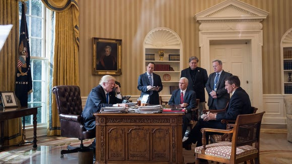 President Trump speaks on the phone with Russian President Vladimir Putin in the Oval Office of the White House, Jan. 28, 2017 in Washington, D.C. Also pictured, from left, White House Chief of Staff Reince Priebus, Vice President Mike Pence, White House Chief Strategist Steve Bannon, Press Secretary Sean Spicer and National Security Advisor Michael Flynn.