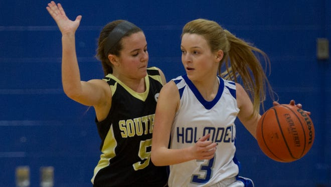 Southern's Tierney Goetz closely guards Holmdel's Jen Inman. Southern Regional vs Holmdel in SCT Girls Basketball Tournament on  February, 19, 2015.  Peter Ackerman/Staff Photographer