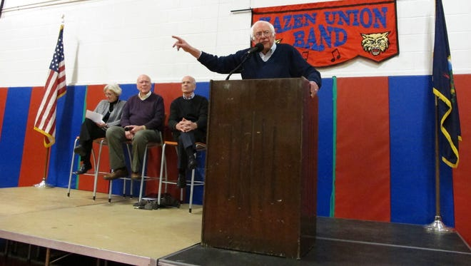 U.S. Senators Bernie Sanders, speaking,  and Patrick Leahy and Rep. Peter Welch hold a town hall meeting with constituents Saturday, March 25, 2017, in Hardwick, Vt. The three-member congressional delegation called the defeat of the Republican health care plan a victory. Sanders says he'll introduce a 'medicare for all' bill.