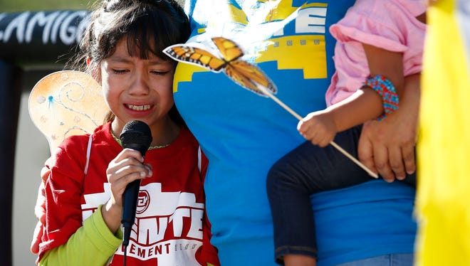 Akemi Vargas, 8, cries as she talks about being separated from her father during an immigration family separation protest in front of the Sandra Day O'Connor U.S. District Court building in Phoenix.
