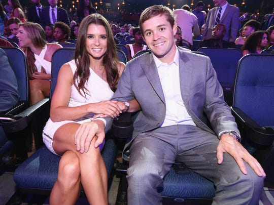 NASCAR drivers Danica Patrick (L) and Ricky Stenhouse Jr. attend The 2014 ESPYS at Nokia Theatre L.A. Live on July 16, 2014 in Los Angeles, California.
