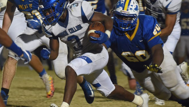 Barron Collier RB Dana Brown (3) makes a big run in the 2nd half during the game against Largo in the 2017 Florida High School Football Playoff Brackets: FHSAA - Class 6A tournament in Largo, Florida on Friday, Nov. 10, 2017.
