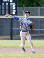Horseheads third baseman throws to first for an out