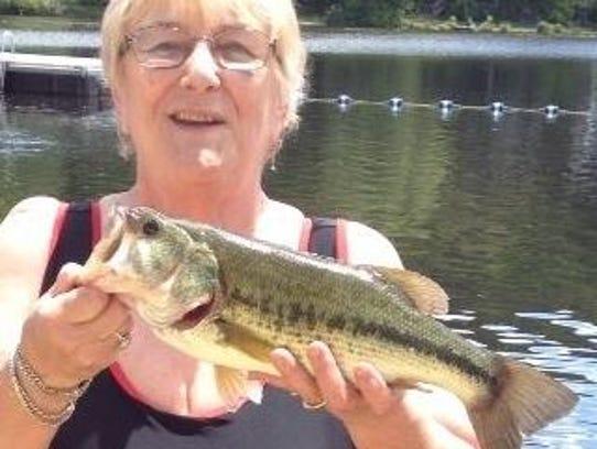 Marilyn Utz holds a striped bass