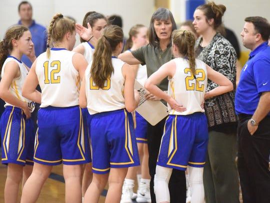 Mountain Home junior girls' coach Brenda Yancey instructs