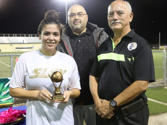 The Venue Slay's Brianna Benito with the Golden Boot award. From left: Benito; Jojo Camacho, Ambros marketing manager; and Gian Tenorio, GFA executive committee member.