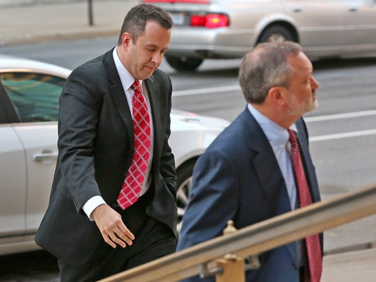 Former Subway pitchman Jared Fogle, left, enters the