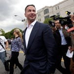 "Mike ""The Situation"" Sorrentino's tax evasion trial has been pushed back from March to September. Reporters and photographers crowd around him as he leaves the federal courthouse in Newark after a Sept. 24, 2014 court appearance."