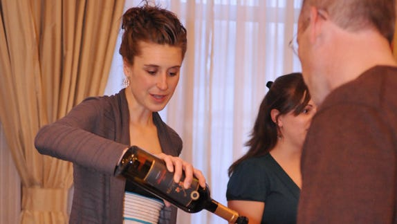 Guests sample wines at the Winter Wine Festival at the Stonewall Jackson Hotel in Staunton.