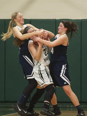 Burlington's Norah Mitchell, right, returns to lead the Seahorses this winter.