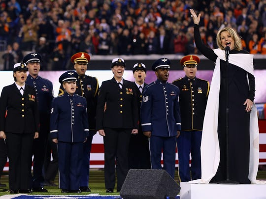Opera singer Ren?e Fleming signs the national anthem during Super Bowl XLVIII at MetLife Stadium on February 2, 2014.
