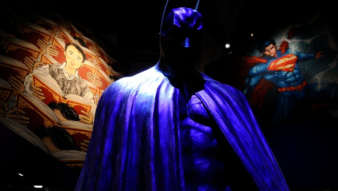 "7/23/14 5:17:08 PM -- COMIC CON / PREVIEW NIGHT ---San Diego, CA, U.S.A.: A state of the ""Dark Knight"" stands in the middle of DC Entertainment's booth during preview night at Comic Con International. DC is celebrating Batman's 75th anniversary with an extensive display at Comic Con International."