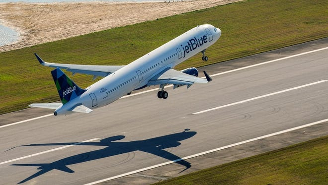 A JetBlue Airbus A321 takes off from Airbus' assembly line in Mobile, Ala.