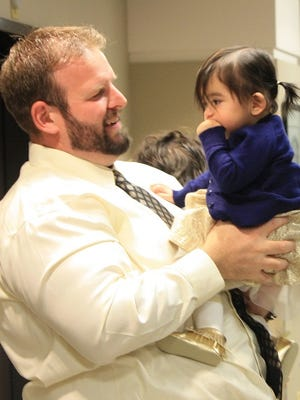 Ben Schumacher with newly adopted daughter Elena, 2.