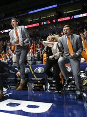 Tennessee basketball managers and players celebrate during an SEC Tournament game against Auburn on March 9.