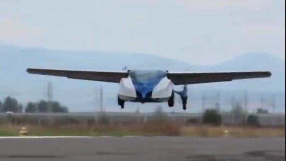 An Aeromobile flying car takes off.